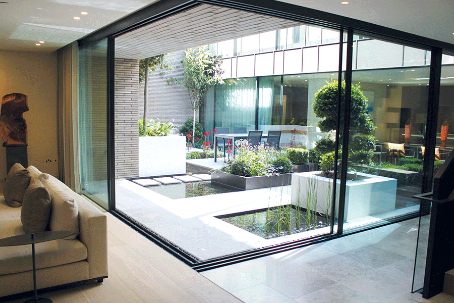 Notting Hill courtyard water feature gardens - Fabric Magazine